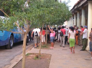 Casa owners in Vienalez as a bus arrives full of travellers