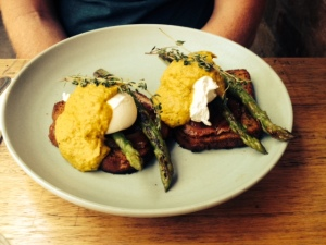 poached eggs on pumpkin bread served with asparagus and