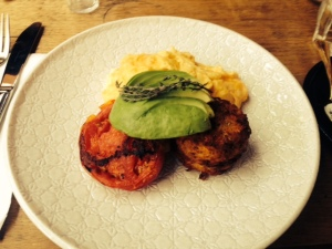 scrambled eggs with potato rosti, avocado and grilled tomato
