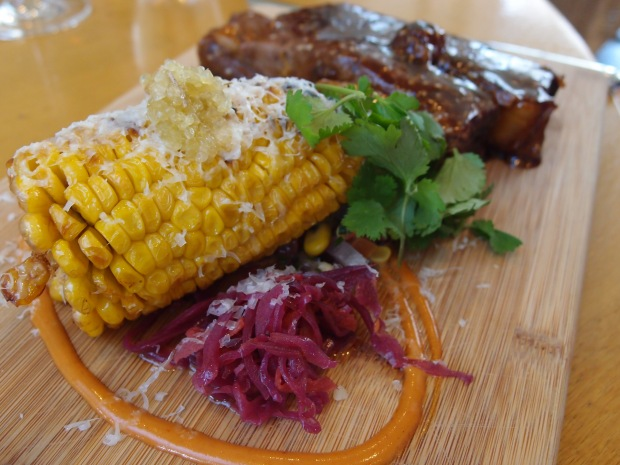 BBQ beef ribs with grilled corn, chipotle, lime and grated saganaki