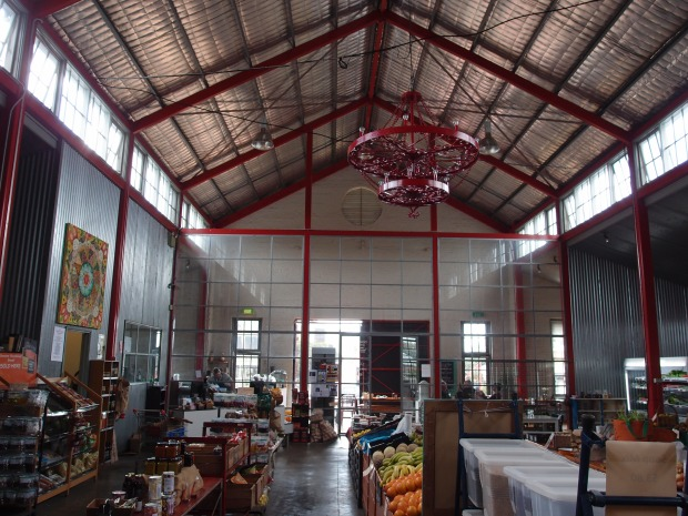 The old barn converted into a spacious marketplace filled with fresh goodies