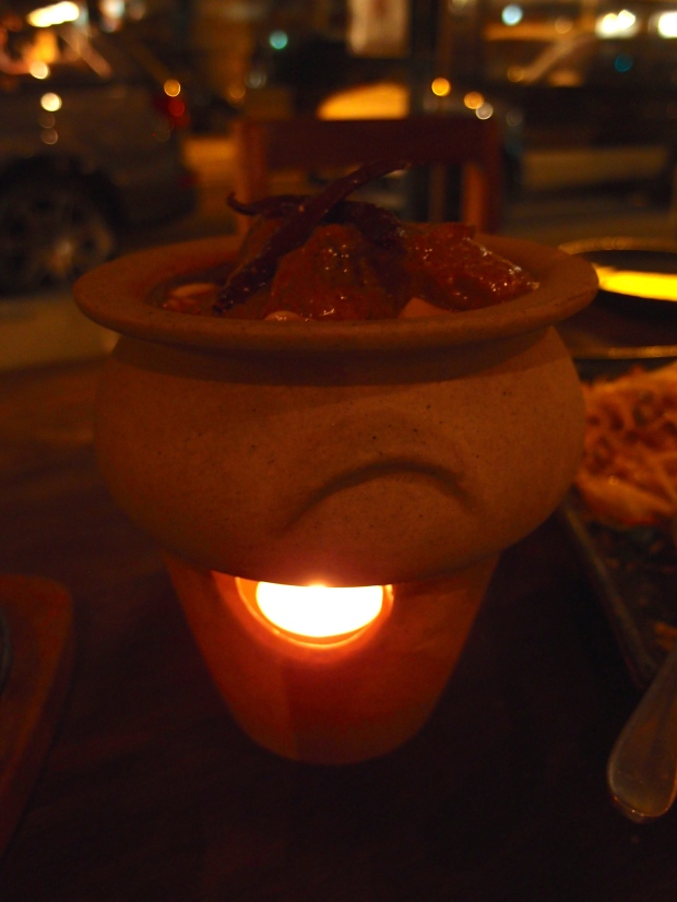 A traditional thai clay pot with piping hot Mussaman Curry