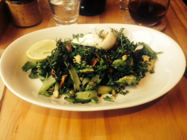 A superfood salad with activated almonds and kale