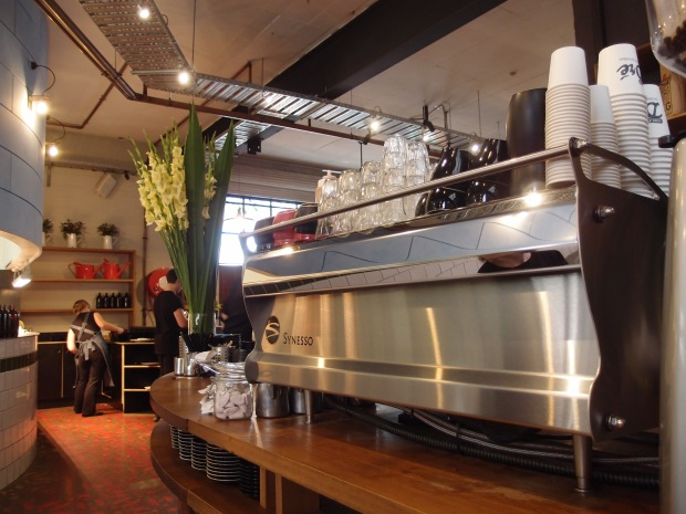 The curving rhythm of the cafe and it's machine