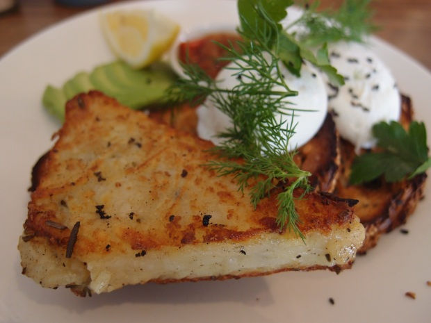 Poached eggs with a side of potato roesti, relish and avocado