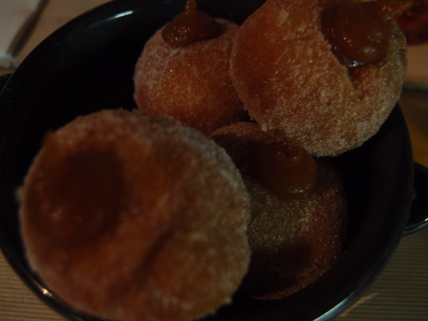 Spanish doughnuts - quince filled with dusted sugar