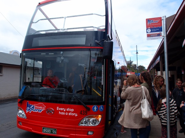 The red and blue stop signs dotted around the bus route