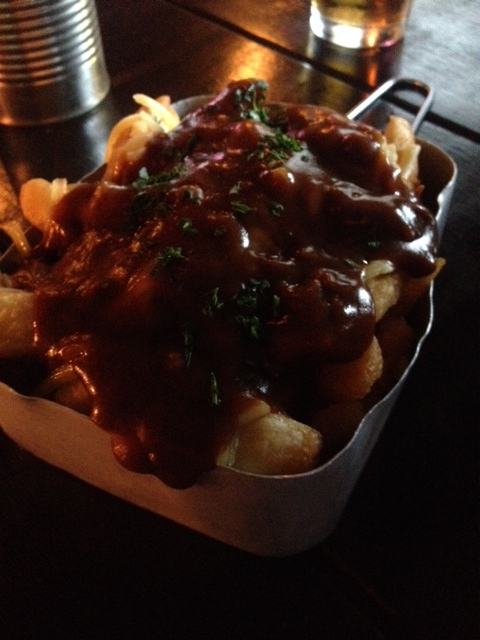 One large basket of steaming hot chips covered in cheese and gravy. PERFECTION