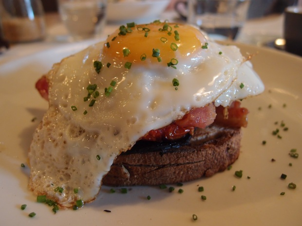 Fried egg stack with tomato and mushroom on sourdough
