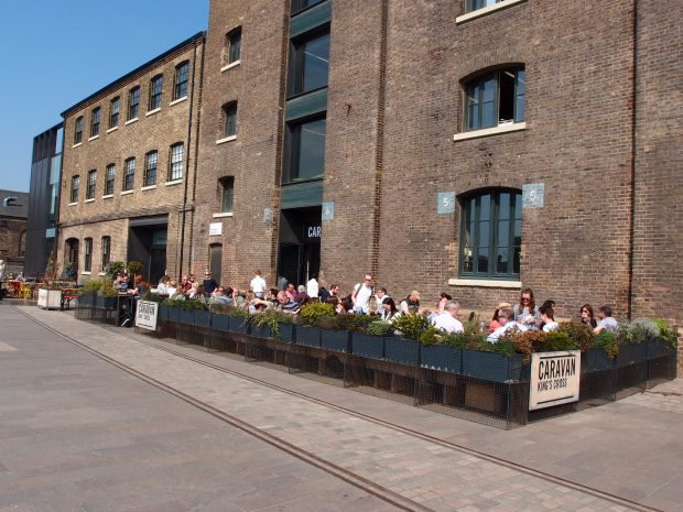 The old granary building and outside dining area at Caravan Restaurant and Coffee Roasters