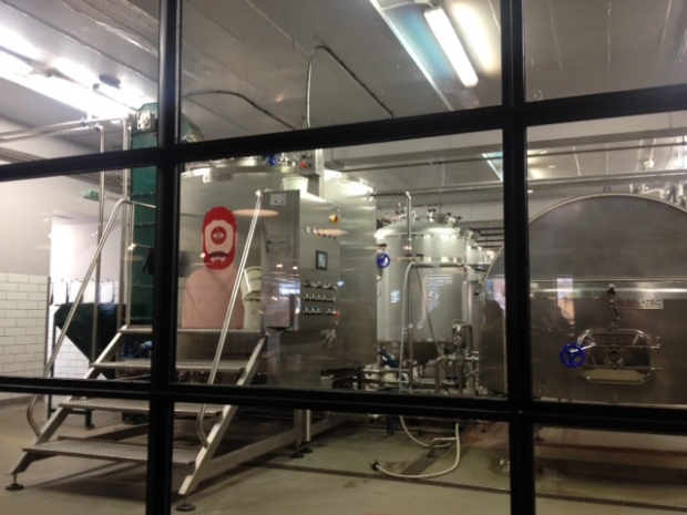 A view from the brew bar into the brewery.