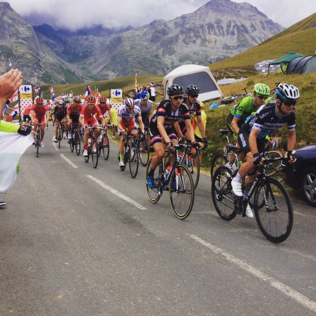 The peloton make their way slowly toward le col de la criox de fer.