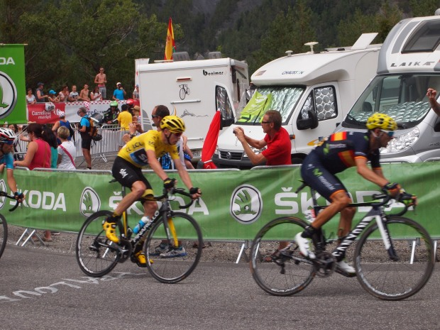 Chris Froome races around the corner in chase of the breakaway.