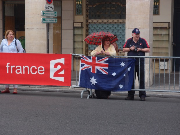 Two Australian spectators setting up early before the wind intensified and the rain set in.