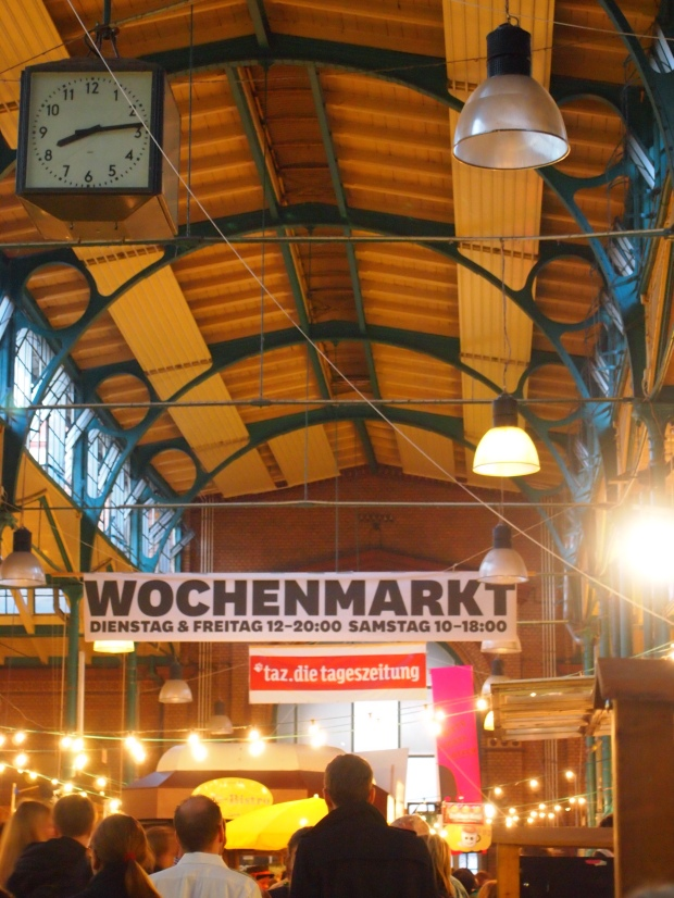 The grand entryway and roof inside Markthalle Neun.