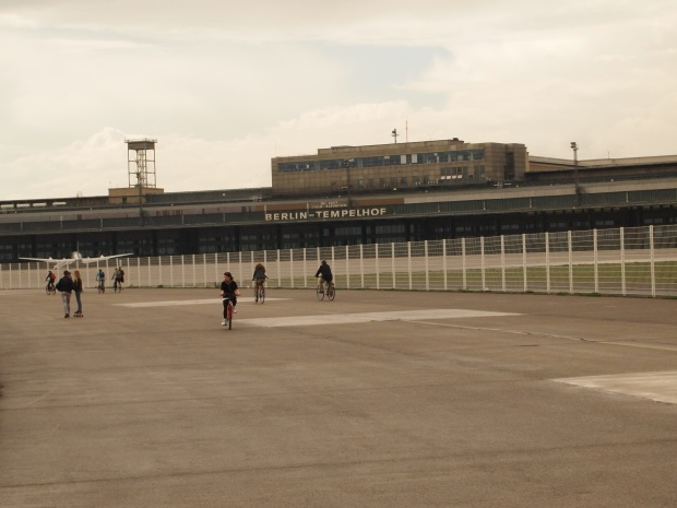 The vast concreted area separating the terminal and runways.