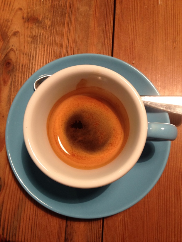 An espresso and blue cups at Father Carpenter.