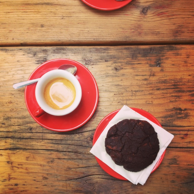 Red cups, chocolate cookies and an espresso.
