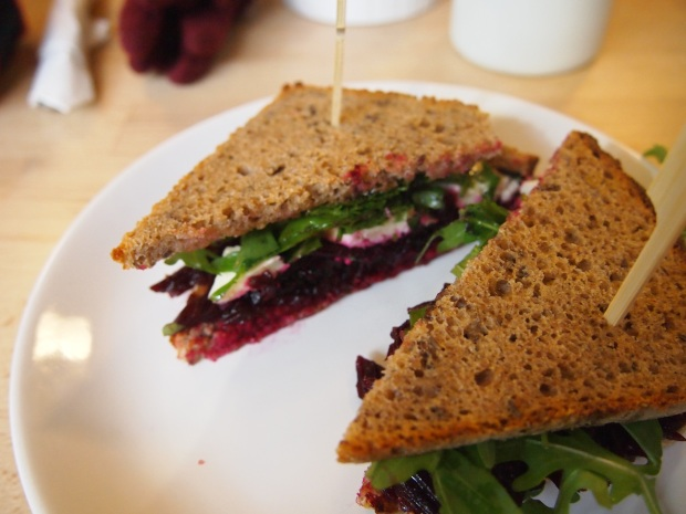 A tasty breakfast sandwich with Hummus, Beetroot, salad and goat cheese from Original Coffee.