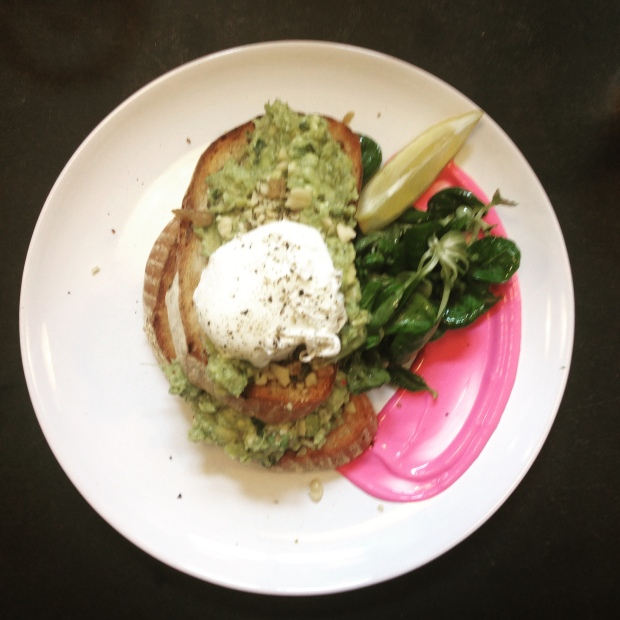 Smashed avocado on toast with dhaka, poached eggs & beetroot pure.