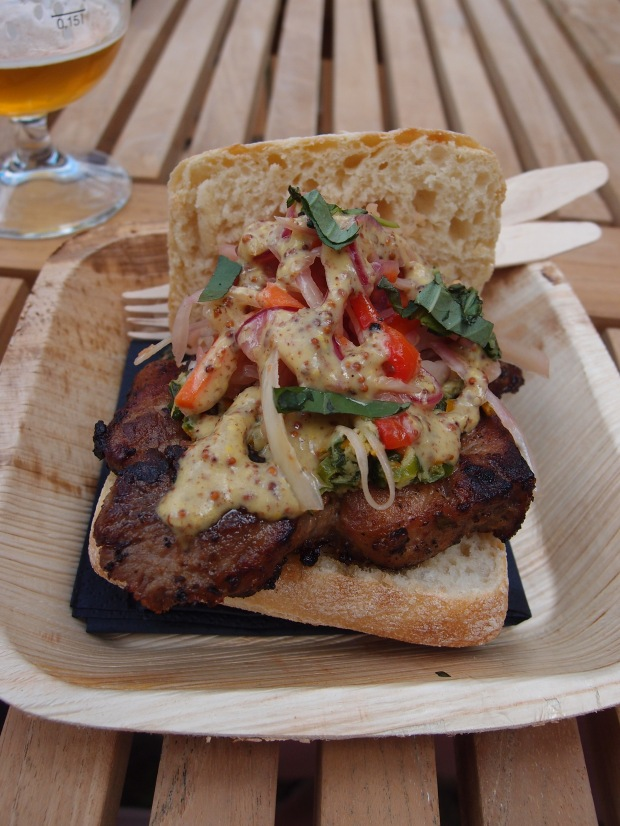Pork sandwich with coleslaw.