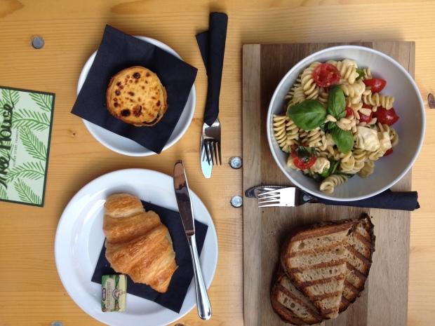 Portuguese tarts, croissant, and fresh pasta salad.