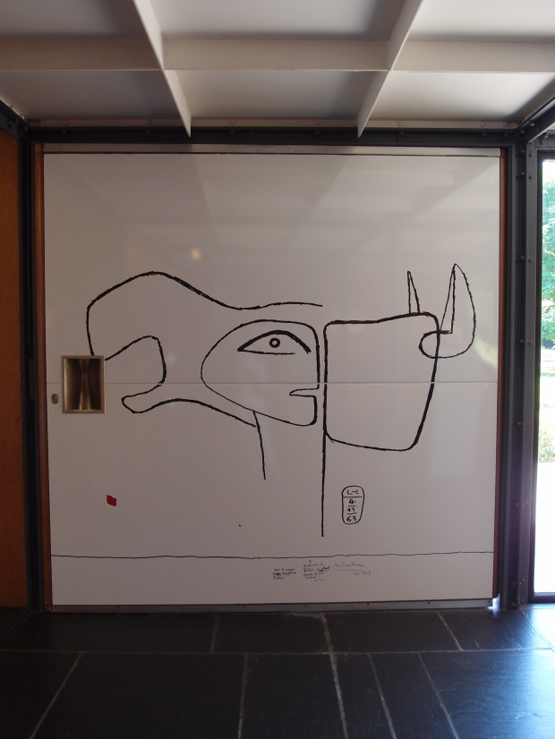 360 degree rotating wooden door with a Corbusier drawing.